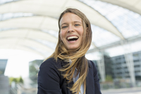 Portrait of young businesswoman laughing