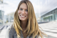Portrait of young businesswoman with long blond hair
