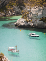 Elevated view of two boats anchored in bay, Menorca, Balearic islands, Spain