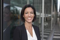 Portrait of happy mature businesswoman outside  airport