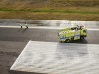 Truck on airport runway, Keflavik, Iceland