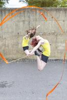 Young women practising ribbon dance on court 11015268781| 写真素材・ストックフォト・画像・イラスト素材|アマナイメージズ