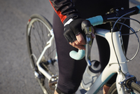 Waist down view of cyclist on bicycle