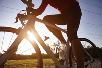 Cyclist riding during sunset