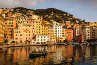 Elevated view of fishing boat leaving the harbor, Camogli, Liguria,  Italy