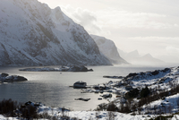 Snow covered mountains and fjord near Unstad, Lofoten Islands, Norway