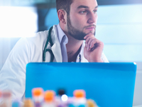 Doctor thinking about patient medical test results, samples in foreground