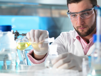 Scientist experimenting with chemical formula in laboratory