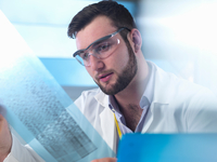 Scientist examining DNA code in laboratory