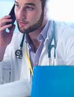 Junior doctor using smartphone in clinic