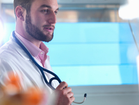 Portrait of male junior doctor in clinic