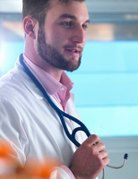 Portrait of young male junior doctor in clinic