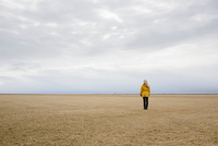 Woman standing on field, Sudurland, Iceland