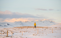 Woman enjoying view of snow-covered mountains, Markarfljot, Iceland
