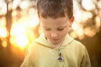 Portrait of boy wearing hooded top looking down
