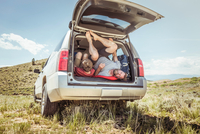 Mature man and teenage son getting out of off road vehicle, Bridger, Montana, USA