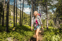 Teenage female hiker hiking in forest, Red Lodge, Montana, USA