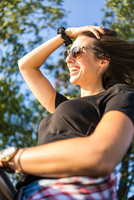 Happy young woman with sunglasses
