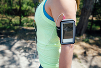 Mid section of woman wearing activity tracker on arm