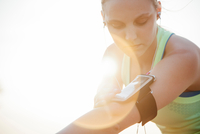 Woman wearing activity tracker on arm looking down