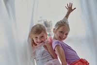 Girls in costume posing beside curtains 11015274425| 写真素材・ストックフォト・画像・イラスト素材|アマナイメージズ
