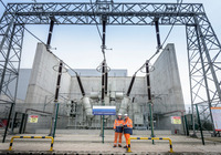 Workers with 400KV transformer in gas-fired power station, low angled view