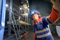 Engineer repairing furnace in gas-fired power station