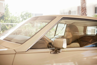 Young woman behind wheel