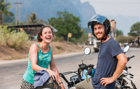 Young couple, biking the Thakhek loop in Khammouane province, Laos