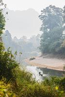 Man rowing boat down river, Thakhek, Khammouane, Laos