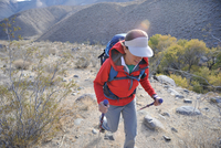 Hiker exploring desert, Cottonwood Canyon, Death Valley National Park, California