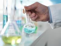 Scientist preparing a chemical formula in a conical flask during an experiment in the laboratory