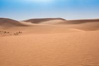 Empty desert landscape and blue sky, Dubai, United Arab Emirates