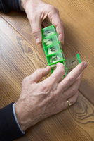 Man taking medication out of pill box