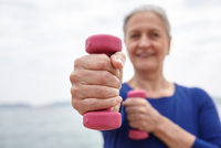 Mature woman exercising with hand weights