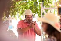 Market trader lighting cigar