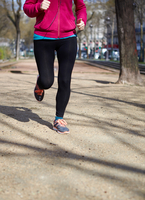 Low section of woman jogging