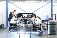 Engineers building car in racing car factory