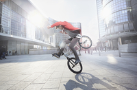 BMX Biker doing stunt in urban area