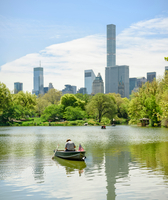 Central Park boating lake and skyline, New York, USA