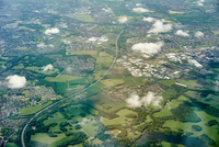 Aerial view of green fields and motorway, England, UK