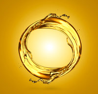 Transparent liquid swirling against yellow background