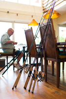 Man working with his fishing rods in dining room