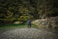 Couple by river, Lynn Canyon Park, North Vancouver, British Columbia, Canada