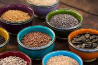 Bowls of sunflower, sesame, pumpkin, linseed,chia, flax and nigella seeds