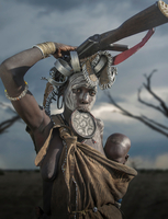 Woman of the Mursi Tribe with Kalashnikov and small child, Omo Valley, Ethiopia
