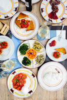 Overhead view of traditional Italian meal with cold cuts, mozzarella and caprese salad, Florence, Italy