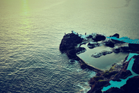 Elevated view of rocky pier in ocean, Madeira, Funchal, Portugal