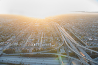 Sunlit aerial view of traffic on highway and flyover, Los Angeles, California, USA