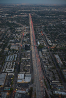 Aerial view of rush hour traffic on highway at dusk, Los Angeles, California, USA